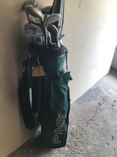 Golf bag and about 18 or more clubs
