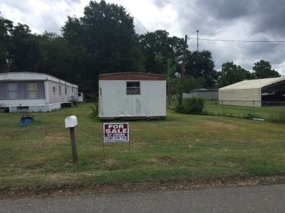 40 foot by 164 foot lot with utilities and small storage shed