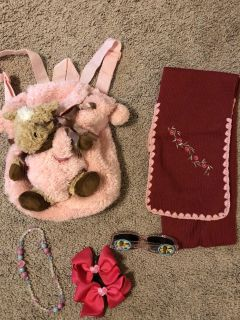 Soft backpack with removal toy, scarf, tiana sunglasses, necklace and unused hair bows