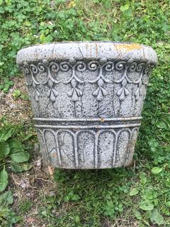 Light weight large pot for plants. Very used. Man-made material. 10 1/2 tall. 12 1/2 inches across