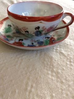 Little tea cup with saucer and plate stand for display