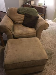 Large beige chair with ottoman
