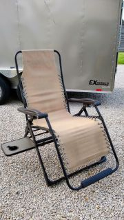 Large zero gravity outdoor lounge chair with cup holder.