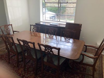 Beautiful antique dining room table with 8 Maitland Smith Chairs