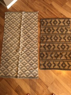 Throw rugs . Kitchen or bathroom size in excellent condition . Cross posted