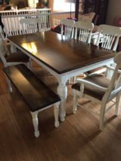 farmhouse table with leaf 6 chairs and a bench sit up to 10 people