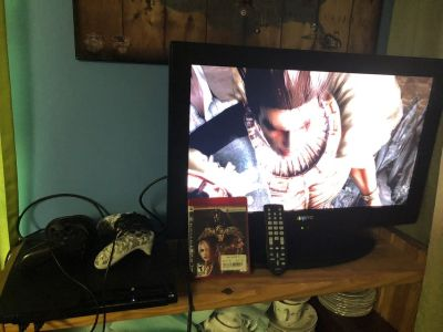 "PS3 With 2 Controllers a Game & Guitar & SANYO 26"" TV with Remote"