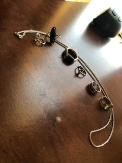 Sterling silver lot of 2toe rings, cross ring, 2 Blk rings, plain ring, and 12 necklace