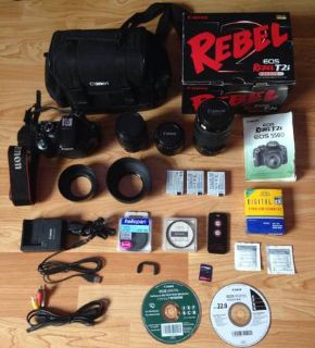 For Sale Canon T2i DSLR camera with 3 lenses  MANY extras