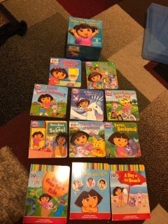 11 Dora s book + sticking toys and 5 sight word books , many puzzles, lego and more