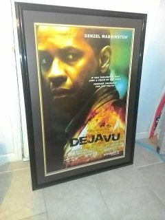 Large black frame with poster