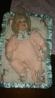 Collectible porcelain baby doll.