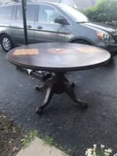 solid wood round table, claw feet