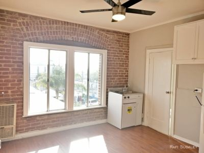 Beautifully Remodeled Bachelor With Exposed Brick in Prime Location