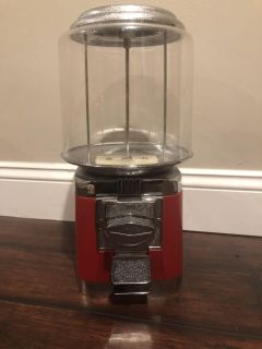 Coin operated candy dispenser