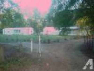 2 Mobile Homes with 1 acre 40,000 firm