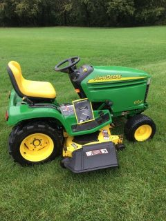John Deere TRACTORS and MISC. EQUIPMENT; BAGGERS,SNOWBLOWERS,PLOWS, DECKS,WHEELWEIGHTS ETC.