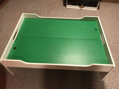 Table with drawers and comes with different types of trains and tracks