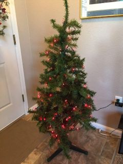 4 foot tree with red lights. Not pre-lit. Just added the lights.