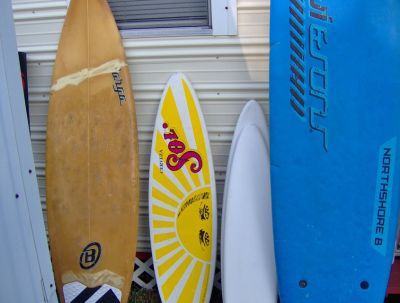 surfboards, surf sign, camping stuff, etc