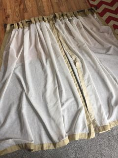 Gold and white curtain panels, set of 2. One button tab needs to be restitched. Each is 58 W x 63 L