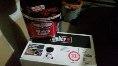 weber grill 22 inch still in box never opened with a 15# bag of charcoal included