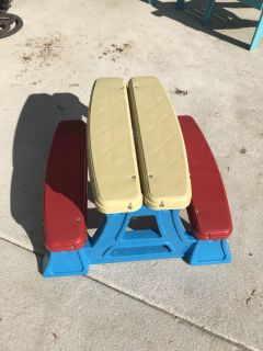 Kids picnic table. Kept mostly indoors but has been on covered patio