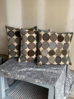 3 throw pillows Guc selling as a set