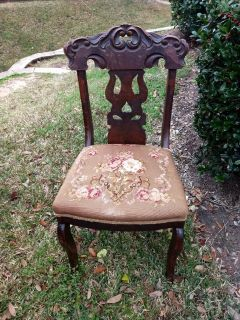 Antique chair with embroidered seat
