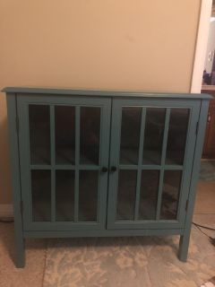 Pretty blue cabinet with glass doors