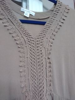 Lightweight tan shirt with lace type details. Like new size XL light material.