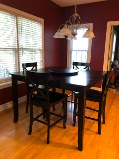 Black bar height wood kitchen table with chairs