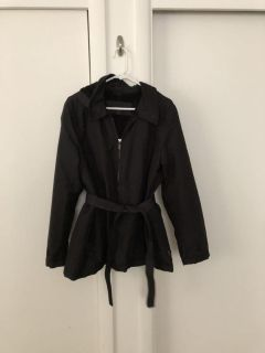 Weather tamer black jacket with hood and strap around waist. Size XL Great condition. $8.00.