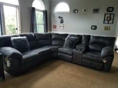 Brand new Signature Design by Ashley Sectional from Ben's Furniture
