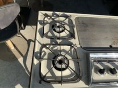 Camping Stove uses Propane Gas 4 Burners and a griddle