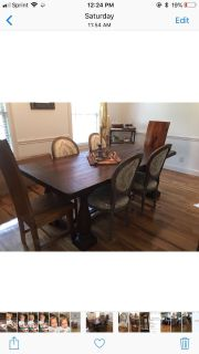 Farmhouse dining room set and six chairs.