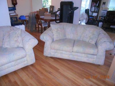 Couch and love seat with matching throw pillows in excellent condition