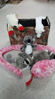 7 plush dog toys and doggie basket container