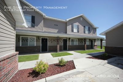 Newer Construction Pheasant Ridge Townhome. This well designed complex offers large master bedroom, solid surface counter tops and built-in wall ironing board. Also includes playgrounds, putting green, volleyball, and basketball!