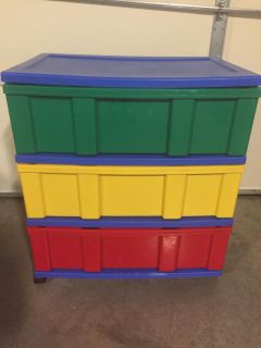 Wide primary colored plastic storage drawers on caster wheels. 24 wide 16 deep 27 tall. In good condition. Read below