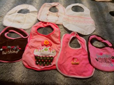 A bundle of seven baby bibs all for $4 good condition