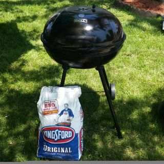 Backyard grill with charcoal briquets bag included.