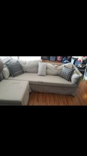 Ikea couch with roll rollaway bed and Storage