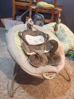 Fisher Price deluxe bouncer with removable mobile. Bounce, vibration, music and sounds. Excellent condition just needs new batteries.