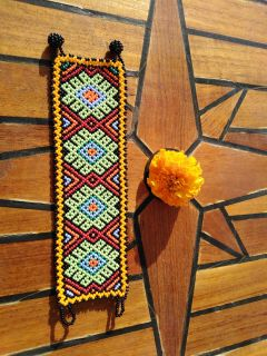 Handmade Mexican Huichol bracelet - approx. 16.50 cm - red, orange, blue and green floral zigzags
