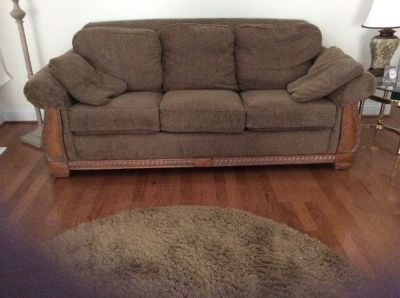 Brown couch with wood trim