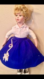 """Vintage 50's Chick in poodle skirt and oxfords. 18"""" tall."""