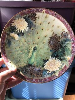 Plate with certificate. Great art on this plate. $5.00