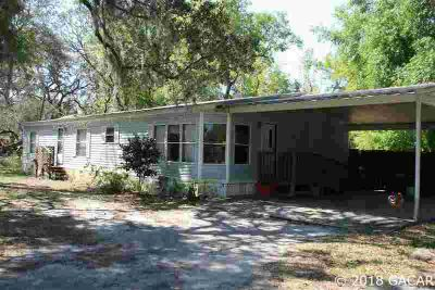 9424 HOLDEN PARK Road HAWTHORNE Three BR, double wide mobile home