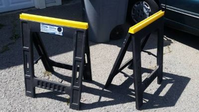 A Pair of Plastic Fold-up Sawhorses